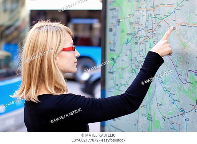Woman looking on the metro map board