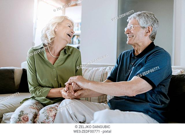 Happy senior couple at home