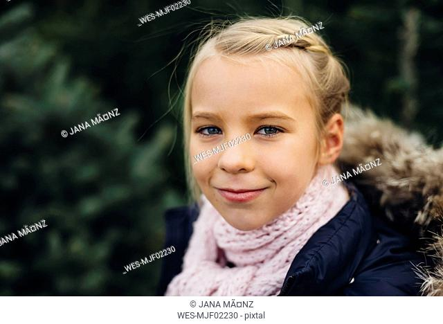 Portrait of a blond little girl, smiling