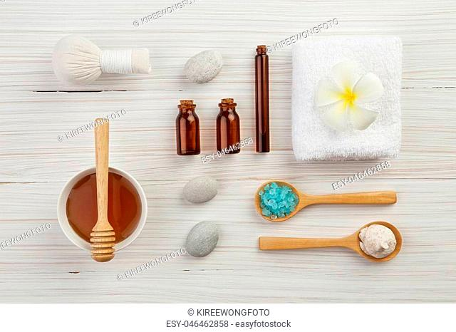 beautiful composition of spa treatment on wooden background top view