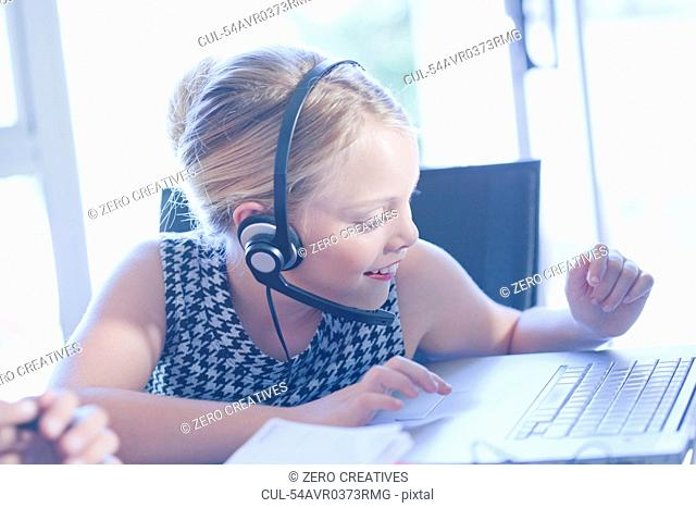 Girl playing businesswoman at desk