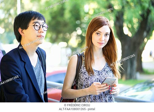 Woman walking on street with friend