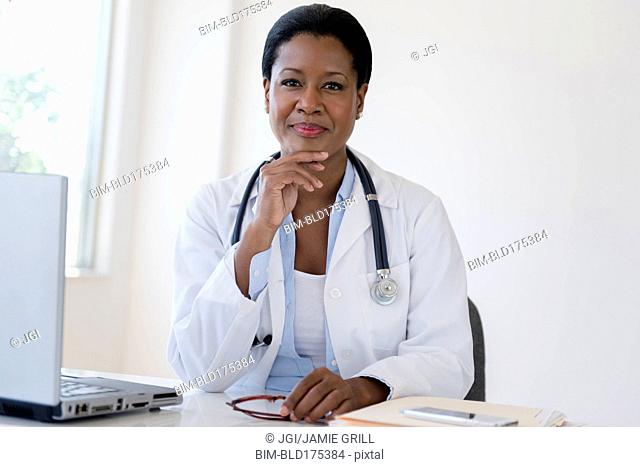 Black doctor sitting at desk