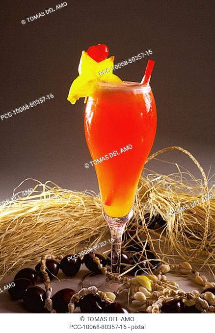 A tropical drink garnished with fruit