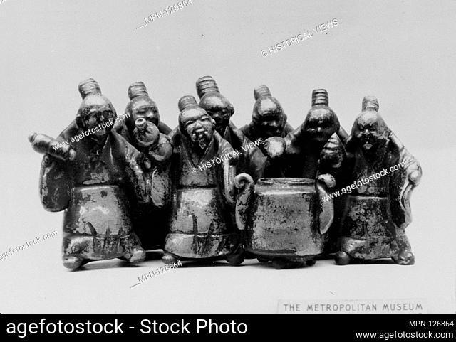 Group of Sennin Standing Around a Camp Kettle. Period: Edo period (1615-1868); Date: 1840; Culture: Japan; Medium: Faience covered in craquelé glazes (Raku...