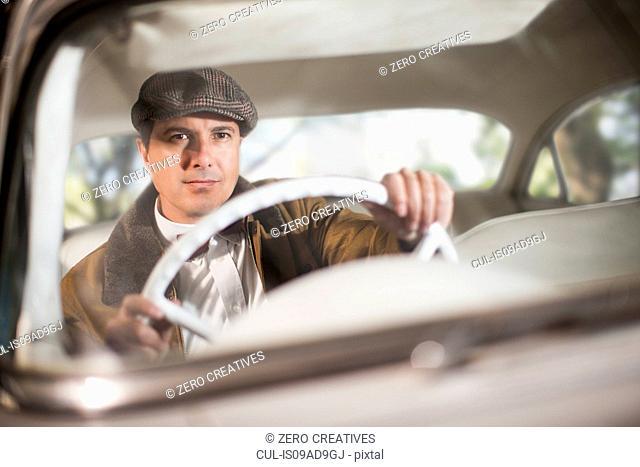 Close up of man in vintage car