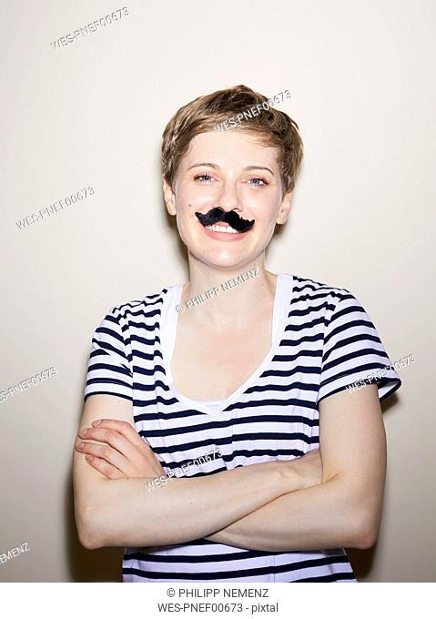Portrait of blond woman, short hair, moustache