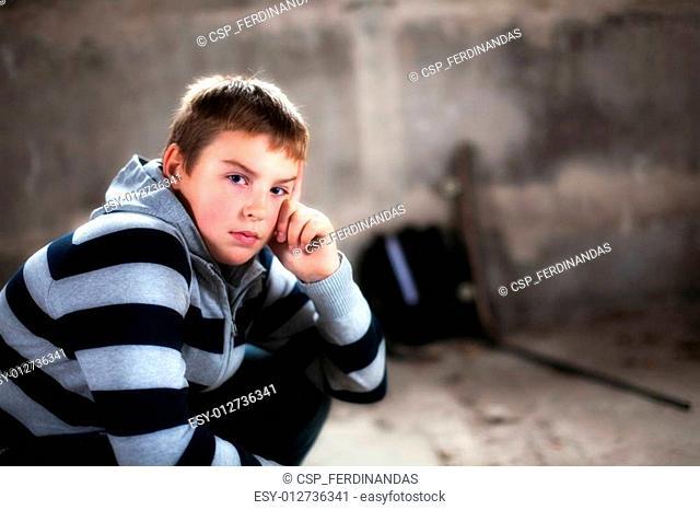Handsome teenaiger looking self assured at camera portrait added glow