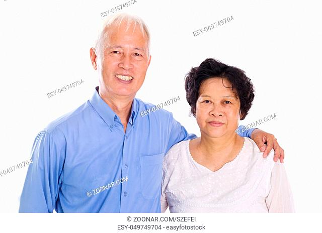 Happy Asian old couple smiling, standing isolated on white background
