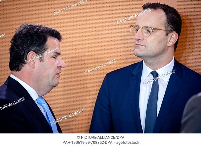 19 June 2019, Berlin: Hubertus Heil (SPD, l), Federal Minister of Labour and Social Affairs, and Jens Spahn (CDU), Federal Minister of Health