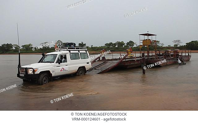 Cars of MSF crossing a river in central african republic