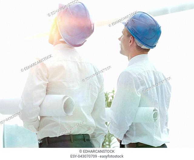 business background. architect and Builder looking at a building