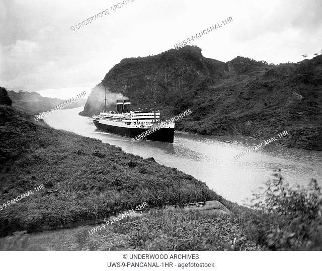 Panama Canal: c. 1935.The Panama Pacific Liner Pennsylvania as it passes by Gold Hill