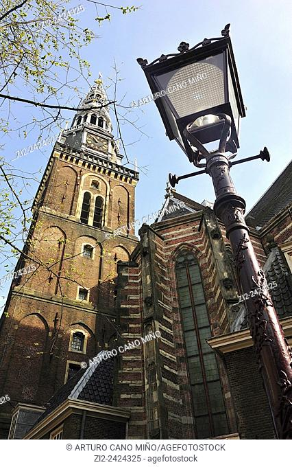 De Oude Kerk or the Old Church, XIVth century, is the oldest in the city. Tower. Amsterdam, The Netherlands
