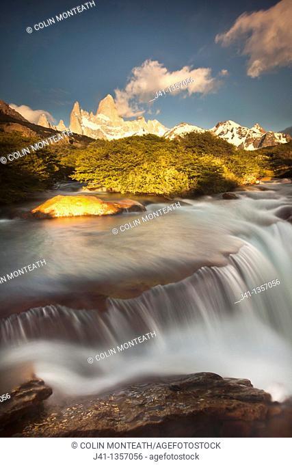 FitzRoy waterfall at dawn under famous rock peak Cerro FitzRoy  El Chalten , Parque Nacional Los Glaciares, Patagonia, Argentina