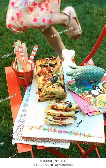 Accordion shaped pizza bread for a children's party in the garden