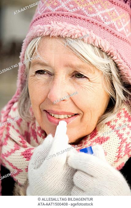 Elderly person with lipstick in winter