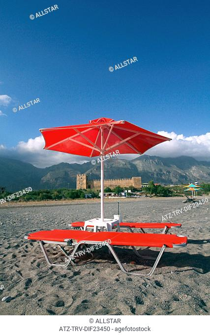 RED SUN BEDS, PARASOLS, CASTLE & MOUNTAINS; FRANGOKASTELLO, CRETE, GREECE; 29/04/2014
