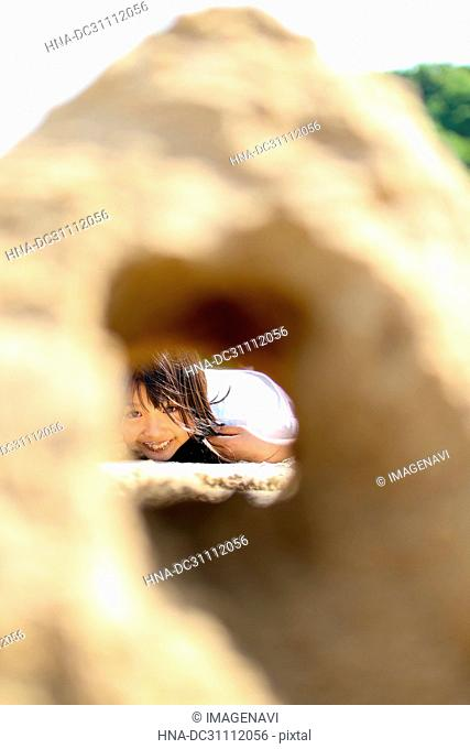 Children and Sand Tunnel
