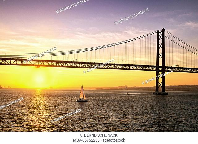 Sundown with bridge the 25th April in Lisbon