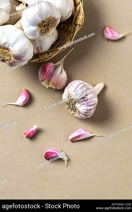 Garlic Cloves and Garlic Bulb in Basket