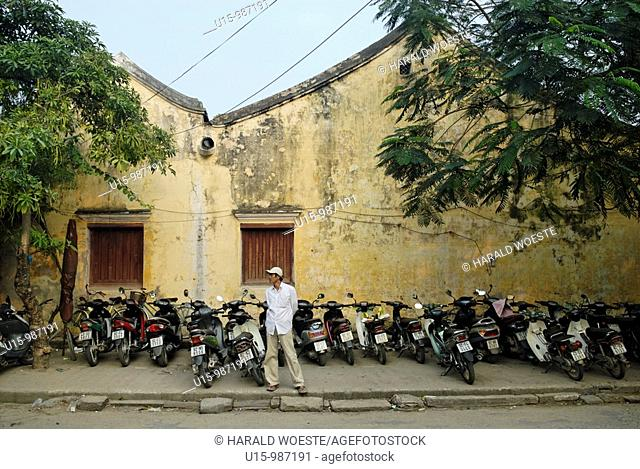 Asia, Vietnam, Hoi An  Hoi An old quarter  Motorbike parking with an attendant  The historic buildings, attractive tube houses