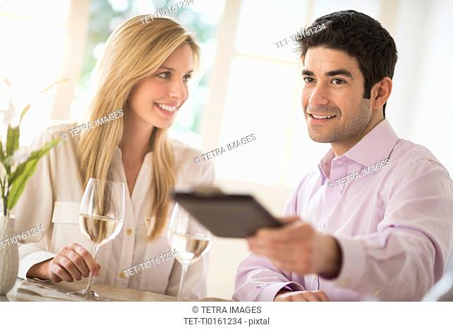 Couple in restaurant, man paying