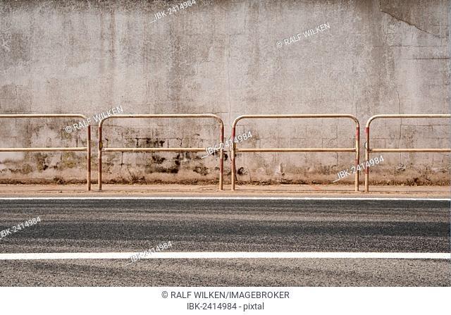 Metal railing in front of a concrete wall, Ferreries, Menorca, Balearic Islands, Spain, Europe