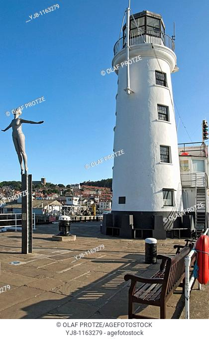 The Diving Belle Sculpture next to the Light House at the harbour of Scarborough, North Yorkshire in England, is the first of two new sculptures comissioned by...