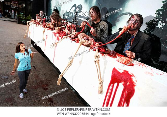 'Zombies' appear in a gory billboard in Shoreditch, London, to mark the arrival of two new The Walking Dead scare mazes at THORPE PARK Resort for its annual...