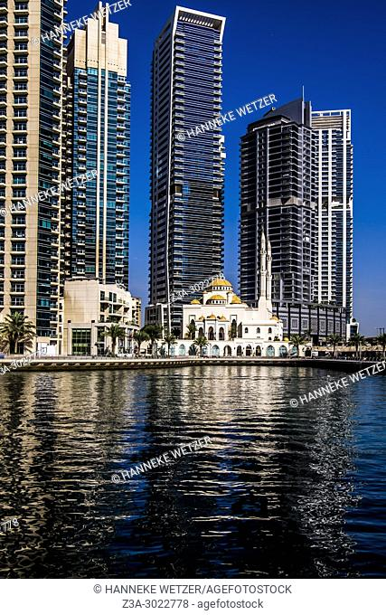 Jumeirah mosque in front of a supertall skyscrapers at Dubai Marina, Dubai, UAE