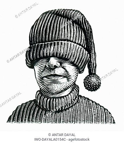 Boy with knitted hat pulled over his eyes