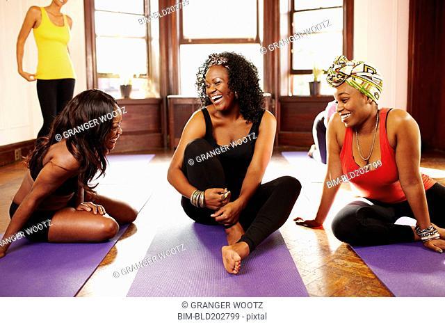 Women talking in yoga class