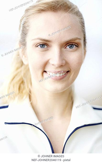 Portrait of young woman smiling and looking at camera