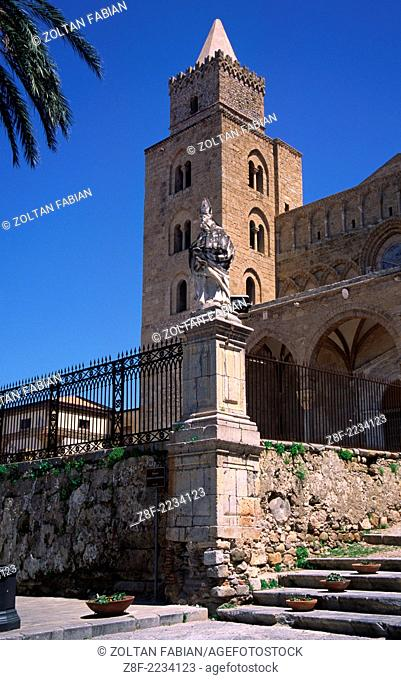 The Cathedral of Cefalu is a straightforward Romanesque basilica with a transept, partly vaulted and partly covered with an open woodwork roof