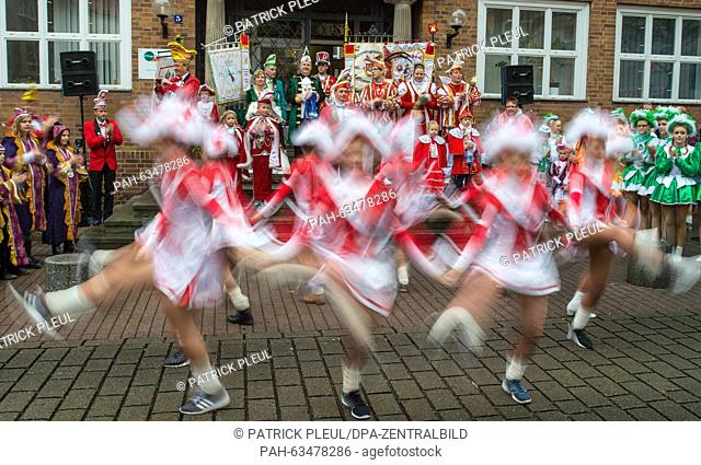 Costumed dancing girls belonging to a Carnival clunb dance at the opening of the Carnival season outside the Town Hall in Cottbus, Germany, 11 November 2015