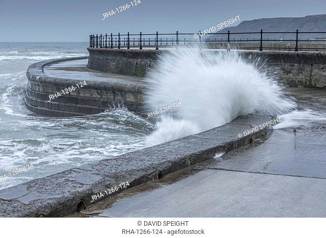Waves crashing into the sea wall at Scarborough, North Yorkshire, Yorkshire, England, United Kingdom, Europe