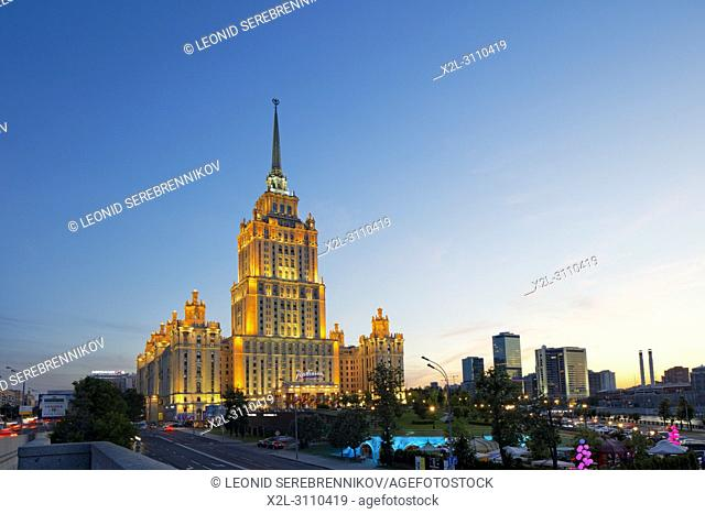 Radisson Royal Hotel Stalinist style high-rise building illuminated at dusk. Moscow, Russia
