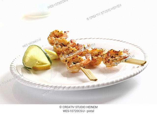 Skewers of Shrimps on plate