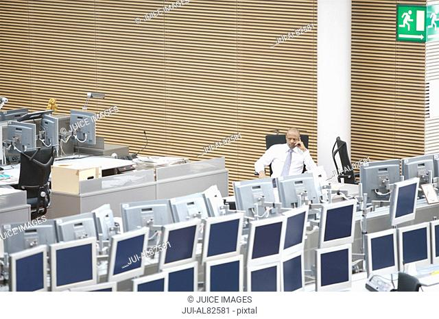 High angle view of businessman at computer work station