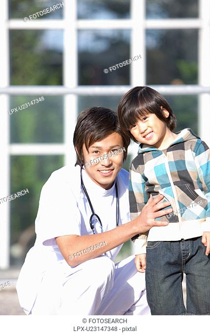 Young Male Doctor and Child