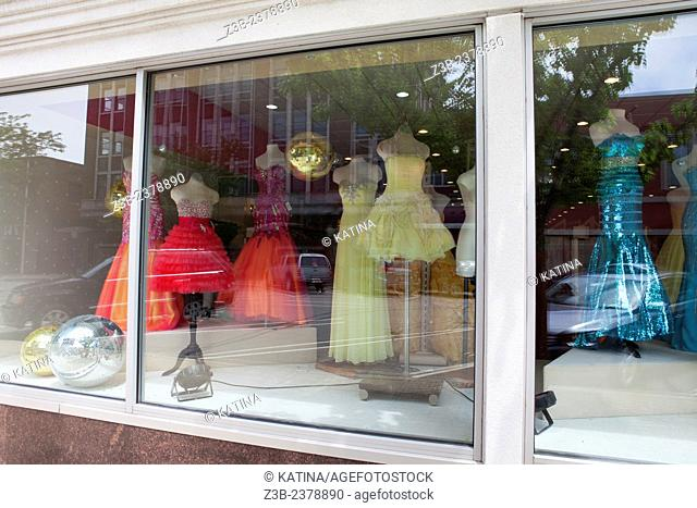 Festive bridal, prom and party dresses in a shop window in Michigan City, Indiana, IN, USA