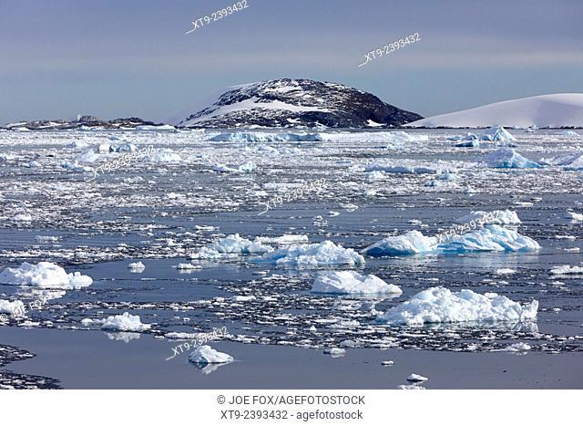 iceberg laden sea in the penola strait towards isla hovgaard Antarctica