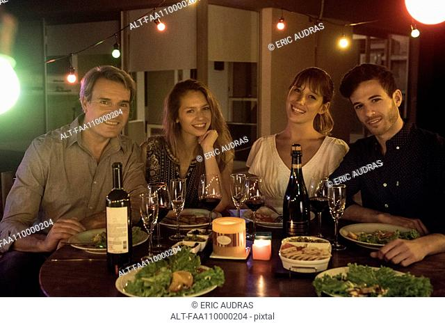 Group of friends enjoying dinner party