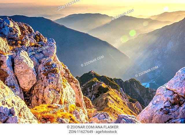 View over Alps in autumn, Bivacco Dino bivouac above Udine, Italy