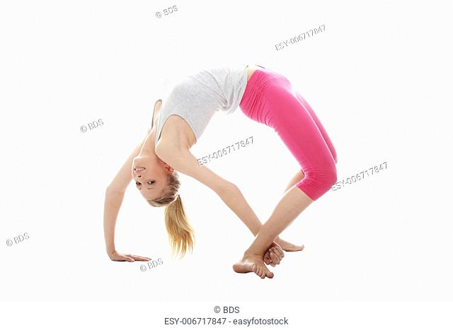 Young woman makes exercise isolated on white