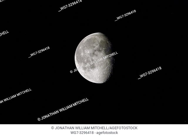 MOON -- 03 Mar 2002 -- Half moon photographed by of one of the Expedition Four crew members on board the International Space Station (ISS) -- Picture...