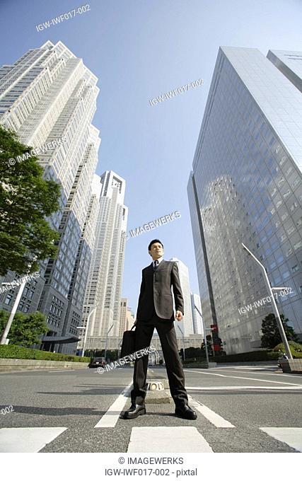Businessman amid office buildings
