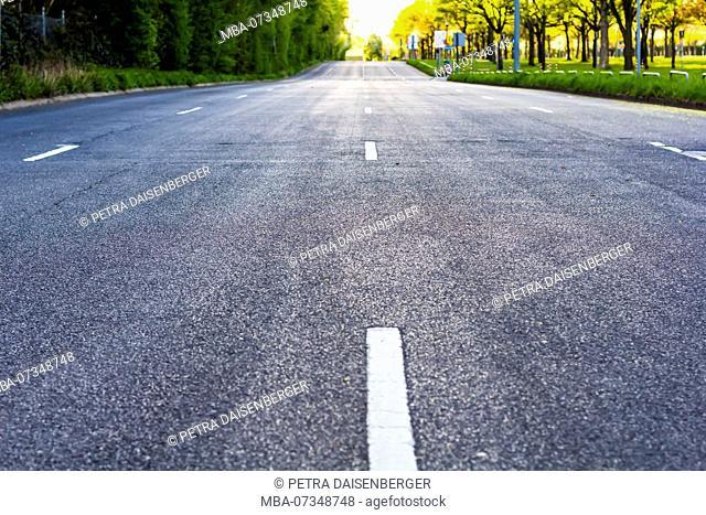 A four-lane road leading to the horizon