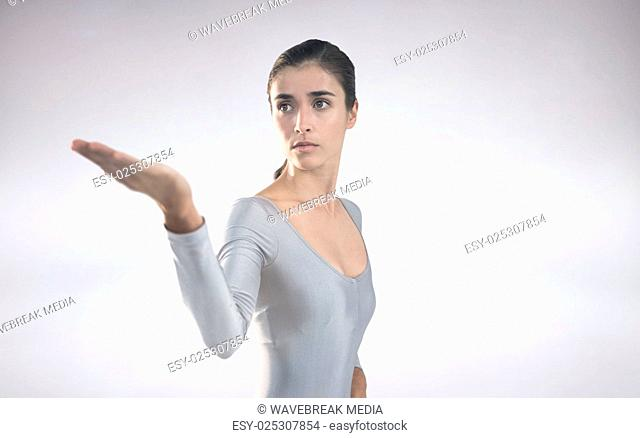 Composite image of beautiful woman gesturing against white background